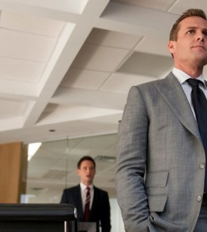 Gabriel Macht as Harvey Specter (foreground), Patrick J. Adams as Mike Ross. Image © USA Network