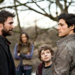 Foreground: Noah Wyle (l) and Drew Roy (r) in Falling Skies. Photo by Cate Cameron/TNT