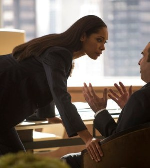Gina Torres and Rick Hoffman in Suits. Photo by: Christos Kalohoridis/USA Network