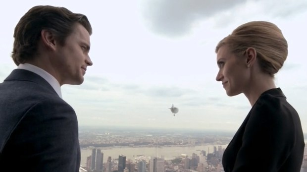 Neal and Sara (Matt Bomer, Hilarie Burton) watch the mini-dirigible depart from the Empire State Building (Image © USA Network)