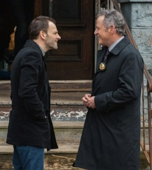 "Jonny Lee Miller(l)  and Aidan Quinn (r) debate the facts in Elementary's ""Dead Man's Switch."" Image © CBS"