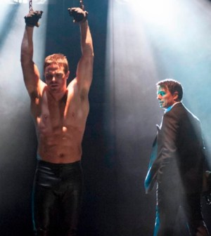 Stephen Amell (l) and John Barrowman (r) in the CW's Arrow