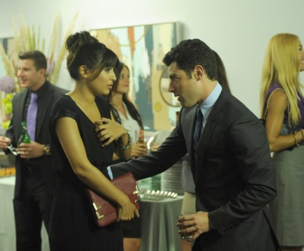 Schmidt (Max Greenfield, R) is surprised when Cece (Hannah Simone, L) shows up at his office party. Image © FOX