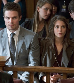 Pictured (L-R): Stephen Amell as Oliver Queen and Willa Holland as Thea Queen -- Photo: Jack Rowand/The CW