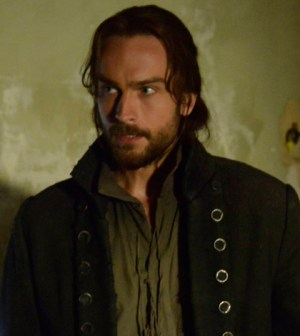 """Ichabod Crane (Tom Mison) searches a colonial-era house which holds secrets in Slepy Hollow's """"Sanctuary"""" Episode. Co. CR: Brownie Harris/FOX"""