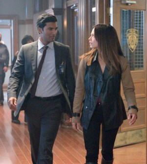 Pictured (L-R): Sendhil Ramamurthy as Gabe and Kristin Kreuk as Catherine -- Photo: Ben Mark Holzberg/The CW