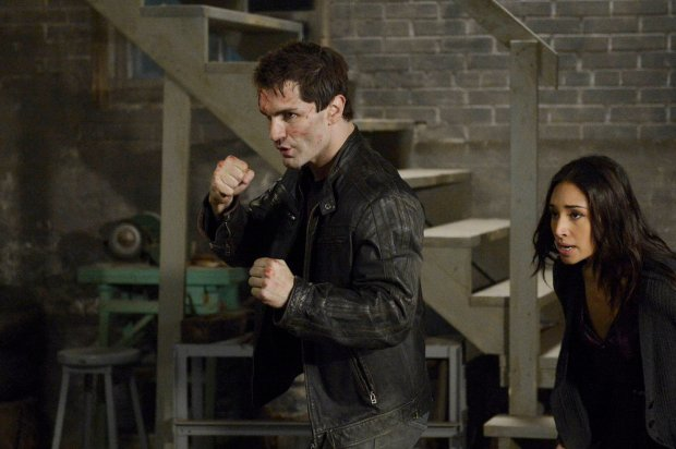 Pictured: Sam Witwer and Meaghan Rath. Photo by: Philippe Bosse / Syfy.