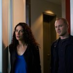 Joanne Kelly and Aaron Ashmore. (Photo by: Russ Martin/Syfy)
