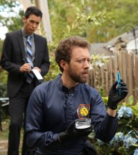 Hodgins (TJ Thyne, R) looks for clues in the murder investigation of a college psychology professor. Also pictured:  John Boyd, L. Co.  Cr:  Jordin Althaus/FOX