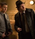 Detective Harvey Bullock (Donal Logue, R) pays James Gordon (Ben McKenzie, L) a visit at Arkham Asylum. Co. Cr: Jessica Miglio/FOX