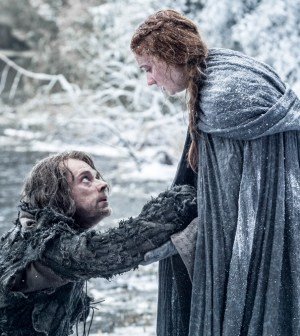 Alfie Allen as Theon Greyjoy and Sophie Turner as Sansa Stark. photo Helen Sloan/HBO