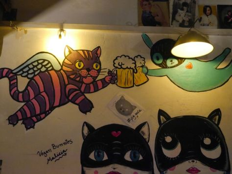 Awesome cat images on the wall.