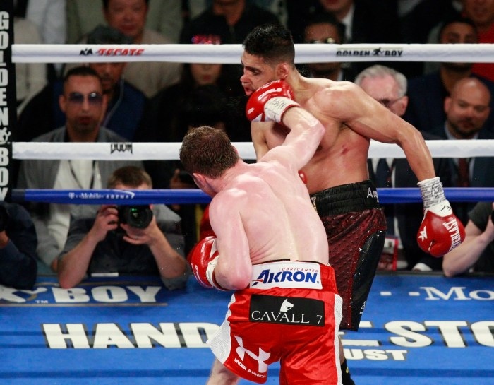 Canelo Alvarez knocks out Amir Khan in the 6th round with a massive overhand right during the WBC Middleweight Title bout, T Mobile Arena, Las Vegas, 7th May 2016. Must Credit - Eoin Mundow