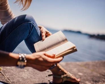 woman-female-reading-book-lake-shore