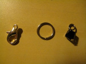 We'll use the Jump Ring (middle) to connect the Lobster Claw and the bead charm.