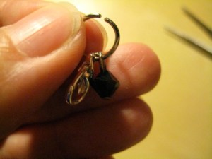 Thread the little ring at the back end of the Lobster Claw and the metal loop of the bead charm onto the Jump Ring.