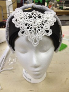 The front will be hidden by the lace applique.