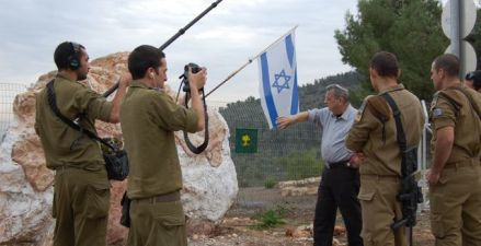 Dr. Freiman has been commissioned by the famed Golani Brigade to sculpt a menorah for their base. Here, Dr. Freiman, is interviewed by an IDF unit as he displays the giant chunk of granite that contains within it a menorah.