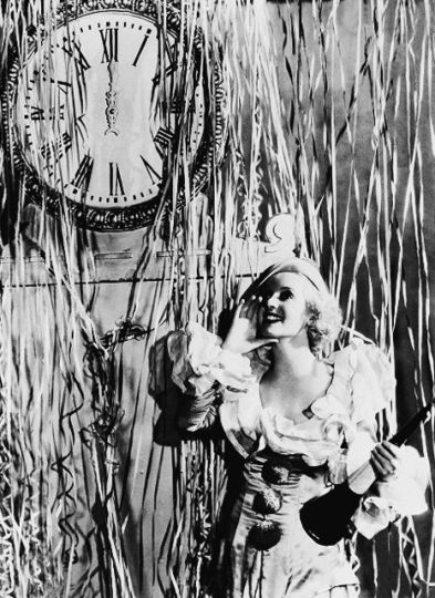 Yes, that's Bette Davis making believe she's happy about posing for a New year studio shot, 1930s.