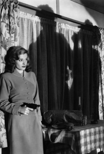 Femme fatale Jane Greer deals lead in Out of the Past (1947).
