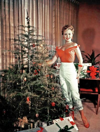Mitzi Gaynor shows off her, um, Christmas tree. Check out those high-waisted Capri pants, 1950's.