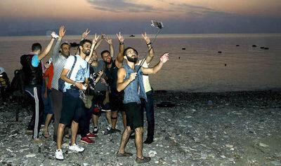 Do these young Muslim men armed with cell phones and selfie sticks look like wretched refugees form war torn states?