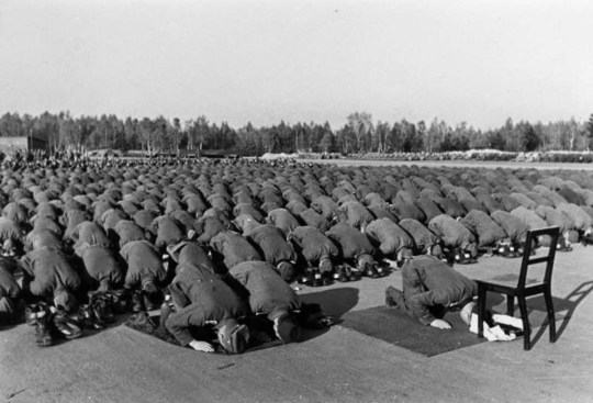 Muslim members of the Waffen-SS 13th division at prayer during their training in Germany, 1943