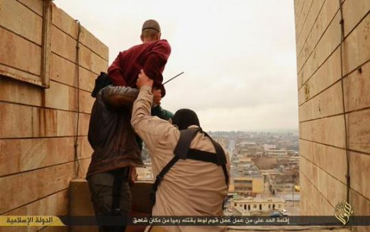ISIS IslamoNazis murder a gay man by throwing him off a roof.