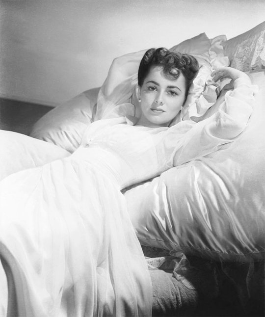"The great Olivia De Havilland just celebrated her a 100th birthday (1 July 1916). ""I would prefer to live forever in perfect health, but if I must at some time leave this life, I would like to do so ensconced on a chaise lounge, perfumed, wearing a velvet robe and pearl earrings, with a flute of champagne beside me and having just discovered the answer to the last problem in a British cryptic crossword."""