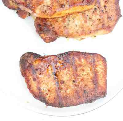 Grilled boneless pork chops marinated in a homemade steak seasoning marinade and grilled to juicy perfection!