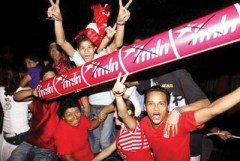 Children joined their elders March 15 to celebrate the FMLN victory that continues the red-turn in Latin America, where liberals and leftists now control governments from Guatemala to Argentina. – Photo: Luis Galdamez, Reuters