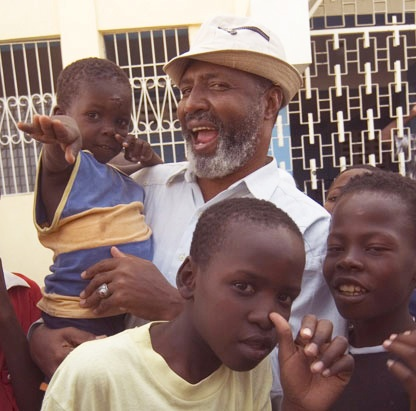 "Jesus-like revolutionary priest Father Gerard Jean-Juste ""suffered the little children to come unto him,"" tending to their needs, body and soul, and fighting for their future and for justice in Haiti."
