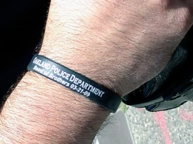 These wristbands were worn by two cops who issued a citation to a bicyclist who was doing nothing wrong except, in their eyes, to be one of the protesters outside the courthouse during killer cop Johannes Mehserle's preliminary hearing. The date on the wristband, March 21, 2009, alludes to the shootout that day that left Lovelle Mixon and four Oakland cops dead. – Photo: Dave Id, Indybay