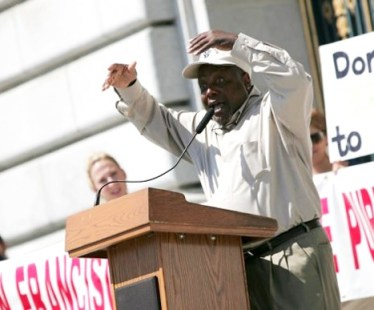 At a June 18 rally on the City Hall steps, Dorsey Nunn, executive director of All of Us or None, passionately decries San Francisco Mayor Gavin Newsoms efforts to slash the budget of the Public Defenders Office.