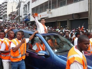 Opposition leader Andre Rajoelina waves to the crowd during an anti-government protest in Antananarivo.  Photo: IRIN