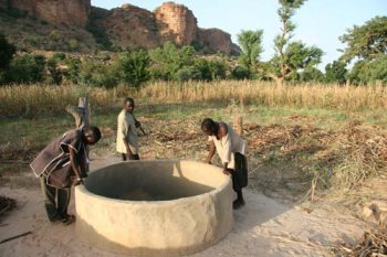 These men of Mali's Dogon Country admire the 30-40-foot well they have dug by hand. The project was financed by Paths of Native Africa.