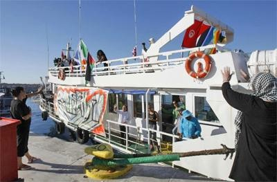 The Free Gaza vessel Spirit of Humanity, a Greek island ferry, with Cynthia McKinney – in a blue jacket and hat – on deck, departs from Larnaca, Cyprus, bound for Gaza to break the Israeli blockade and deliver tons of desperately needed medical, school and construction supplies. – Photo: Andreas Manolis, Reuters