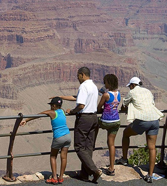 The Obama family gazes at the Grand Canyon from its South Rim on Sunday, Aug. 16, topping off a weekend of hiking, fishing and white-water rafting  during a rain and hail storm  in several national parks. They also marveled at the eruption of Old Faithful, the geyser in Yellowstone.  Photo: Reuters