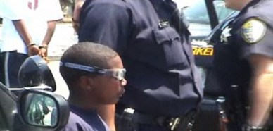"""""""If a child is affected by trauma and the child is never treated, it's going to hugely impact the child's ability to function in the world, and it's going to hugely impact their ability to be successful, to be a healthy, happy human being,"""" says a father whose son was terrorized by police pointing guns at him during a senseless traffic stop. - Frame from 'Oakland Lockdown'"""