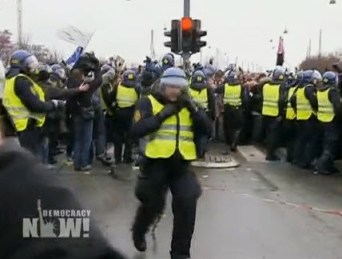 "Baba Jahahara reports that ""more than half of Denmark's 10,500 police officers were assigned to the Bella Center alone, site of the U.N. gathering."" Here they beat back marchers approaching the Bella Center to meet poor nations and Indigenous delegates who walked out in protest Thursday. – Video frame: Democracy Now!"