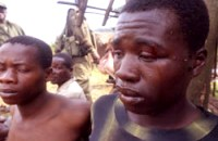 Congolese men in South Kivu, falsely accused of being FDLR militia from Rwanda, are brutalized and detained by FARDC. – Photo: © 2007 Keith Harmon Snow