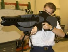 A modified version of this laser rifle created to dazzle enemies by the U.S. Air Force has been adapted by the Department of Justice to inflict pain from a distance. – Photo: U.S. Air Force