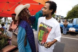 "At the Mo' Better Food Market Shopper in West Oakland, shopper Amaranth Modacure greets founder David Roach. This rare jewel among markets features the produce of Black farmers. It has grown from six farmers to more than 30, but the operation is struggling. ""Our model still hasn't worked yet, financially speaking,"" Roach said. We're ""trying to create something that hasn't been there, trying to make people to come out where they haven't felt safe to come out before."" Mo' Better Food is open from  June to December at Seventh Street and Mandela Parkway from 10 a.m. to 3 p.m. every Saturday. – Photo: Darryl Bush, AP"