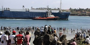 Kenyans watch the huge freighter MV Faina enter the port of Mombasa, Kenya, last month after the Israeli-owned ship, loaded with tanks and other heavy weaponry reportedly destined for Israeli-backed rebels in Darfur, was ransomed and released by Somali pirates, who had held it for four months.  Photo: Antony Njuguna, Reuters