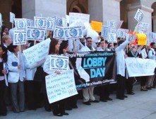 "On Jan. 12, the fourth annual Student Lobby Day, ""It was glorious to behold 500 medical students from schools around the state in their white coats rallying for single payer health care,"" writes Dr. Sumchai."