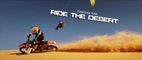 Sick race between a paramotor and a motobike in the stunning landscapes of Tunisia