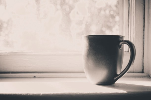 22940 Coffee Cup on a Window Sill
