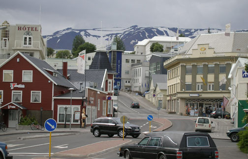 """Known as the """"northern capital"""", Akureyri is the second largest city in Iceland. (Yes, there's a hearse in the foreground- I didn't notice it when I took the picture.)"""