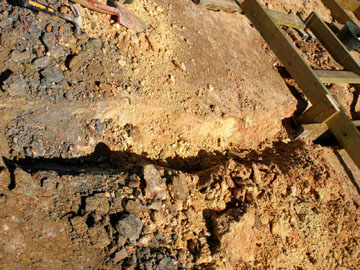 One of the long-term challenges of our platform work is the corrosiveness of the soil. We dug up all kinds of different colors, resulting from different concentrations of minerals. A supplier said the galvanized steel brackets we were using in the framing would dissolve in about seven years, but we're hoping he's wrong. Besides, our budget has limitations, and doing SOMETHING is better than doing nothing.