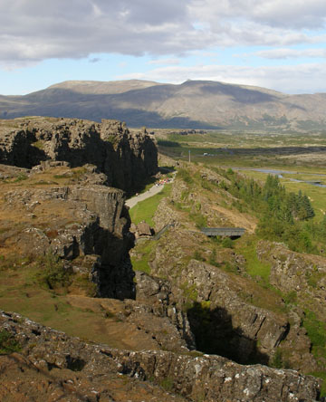 This is the fissure in Þingvellir National Park, which was the location of the first Icelandic Alþing (parliament) in the year 930. The site is at one of the seams of the tectonic plates, which heave apart during earthquakes every once in a while.